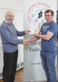 IPF Vice President Sheamus O'Donoghue presenting licentiateship distinction to Paul Grogan