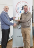 IPF Vice President Sheamus O'Donoghue presenting licentiateship distinction to Terry Hume