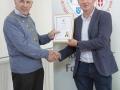 IPF Vice President Sheamus O'Donoghue presenting associateship distinction to Canice Dunphy