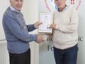 IPF Vice President Sheamus O'Donoghue presenting associateship distinction to Charlie O'Donovan