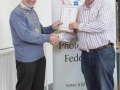 IPF Vice President Sheamus O'Donoghue presenting fellowship distinction to Gerry Kerr