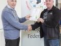 IPF Vice President Sheamus O'Donoghue presenting licentiateship distinction to P. J. McCormack