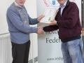 IPF Vice President Sheamus O'Donoghue presenting licentiateship distinction to Robert O'Leary
