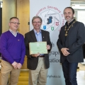 IPF President Michael O'Sullivan & IPF FIAP Liaison Officer Paul Stanley presenting AFIAP distinction to Charles O'Neill.jpg