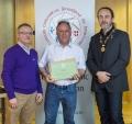 IPF President Michael O'Sullivan & IPF FIAP Liaison Officer Paul Stanley presenting AFIAP distinction to Frank Condra.jpg