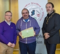 IPF President Michael O'Sullivan & IPF FIAP Liaison Officer Paul Stanley presenting AFIAP distinction to Paul Reidy.jpg