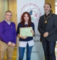 IPF President Michael O'Sullivan & IPF FIAP Liaison Officer Paul Stanley presenting AFIAP distinction to Sigita Playdon.jpg