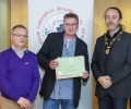 IPF President Michael O'Sullivan & IPF FIAP Liaison Officer Paul Stanley presenting EFIAP distinction to Paul Power.jpg