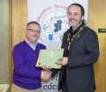 IPF President Michael O'Sullivan presenting EFIAP/bronze distinction to Paul Stanley