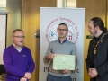 IPF President Michael O'Sullivan & IPF FIAP Liaison Officer Paul Stanley presenting AFIAP distinction to Marek Biegalski.jpg