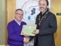 IPF President Michael O'Sullivan presenting EFIAP/bronze distinction to Paul Stanley