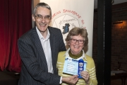 Richard Brown, chairman of the RPS International Jury presenting Margaret Finlay with her FIAP ribbon