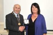 Sheamus O'Donoghue presenting Helen McQuillan with her Silver medal as winner of the Intermediate Section