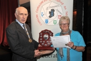 Sheamus O'Donoghue presenting Lilian Webb with the Best Humour Trophy & Honourable Mention in the Advanced Section