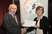 Sheamus O'Donoghue presenting Maria O'Brien with 2 Honourable Mention certificates in the Intermediate Section