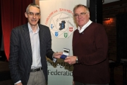 Richard Brown, chairman of the RPS International Jury presenting Raymond Hughes with his historical documentary medal