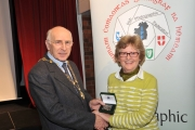 Sheamus O'Donoghue presenting Margaret Finlay with the Audience Vote bronze medal