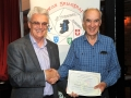 Brendan O'Sullivan presenting certificate to James Hamill, winner of the 3 way battle
