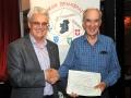 Brendan O'Sullivan presenting certificate to James Hamill, winner of the 3 way battle