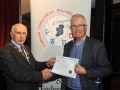 Sheamus O'Donoghue presenting Pat Collins with his Honourable Mention Certificate in the Novice section