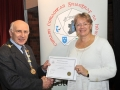 Sheamus O'Donoghue presenting Yvonne Acheson with her Honourable Mention certificate in the Advanced Section