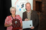 IPF President Dom Reddin presenting Lilian Webb with the best humour Trophy