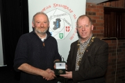 IPF President Dom Reddin presenting Michael Linehan with the audience vote medal
