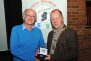 IPF President Dom Reddin presenting the audience vote medal to Ron Davies