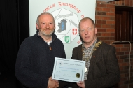IPF President Dom Reddin presenting Michael Linehan with an Honourable Mention Certificate