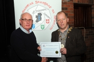 IPF President Dom Reddin presenting an Honourable Mention Certificate to Christopher Doyle