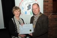 IPF President Dom Reddin presenting an Honourable Mention Certificate to Maria O'Brien