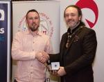 IPF President Michael O'Sullivan pictured with award winner Andrew Flemming