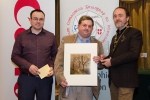 IPF President Michael O'Sullivan and Shane Cowley from Canon Ireland pictured with overall winner Bill Power and winning image