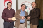 IPF President Michael O'Sullivan and Shane Cowley from Canon Ireland pictured with overall winner Bill Power