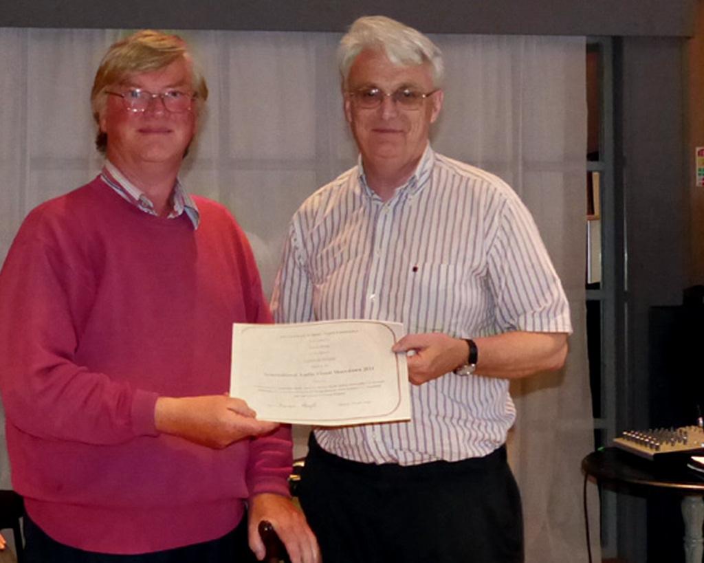 Brendan O'Sullivan, AIPF, chairman, IPF AV Group Committee presenting Edwin Bailey, LIPF with his judge's certificate.